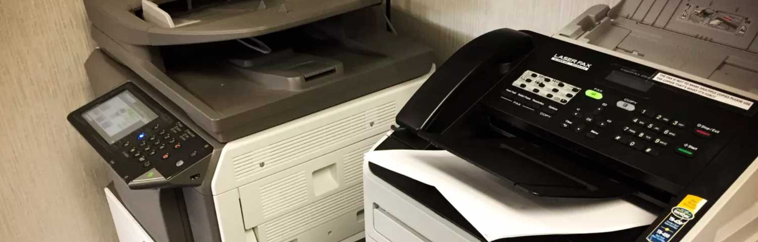 Old office fax machines ready for disposal