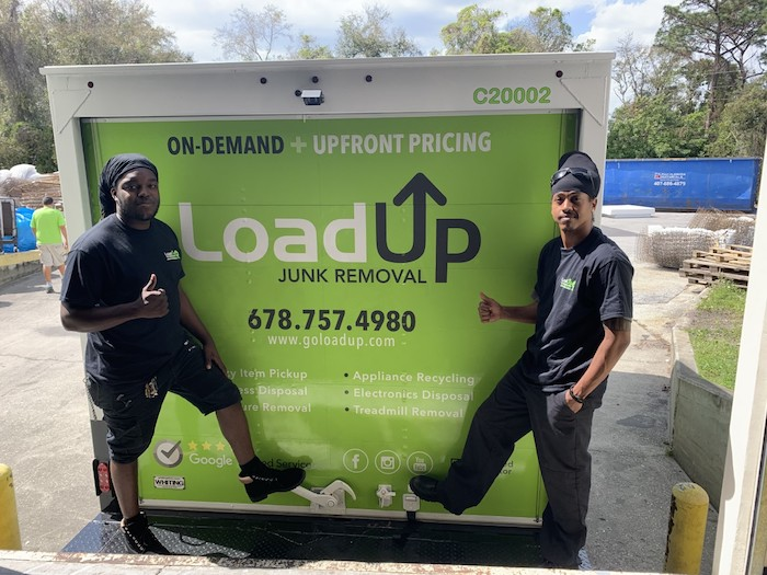 LoadUp team members happily donate picked up furniture in Orlando